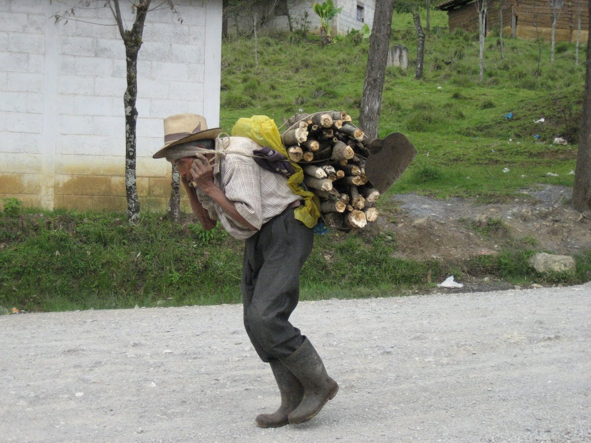 A grandfather carrying wood